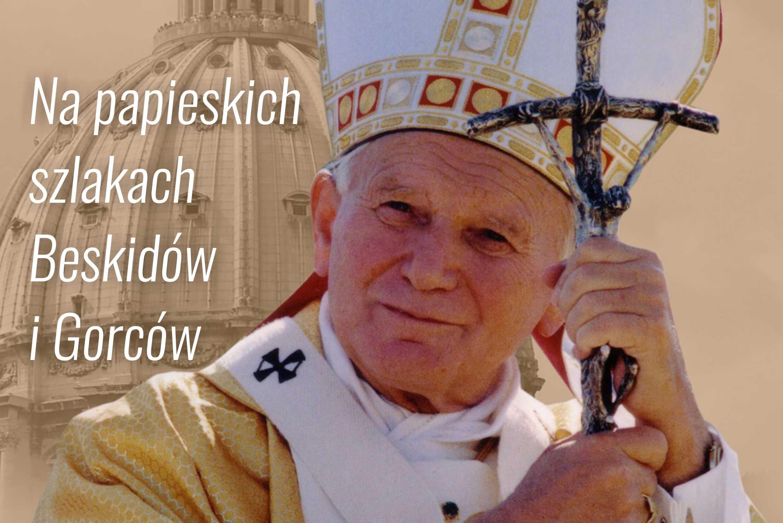 Plakat z napisem: Na papieskich szlakach Beskidów i Gorców. Zdjęcie Papieża Jana Pawła II z krzyżem.