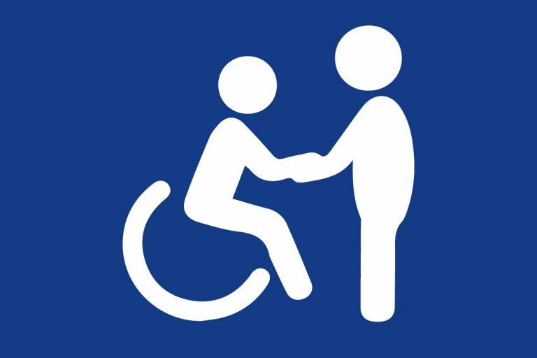 Grafika przedstawiająca osobę niepełnosprawną wraz ze swoim asystentem